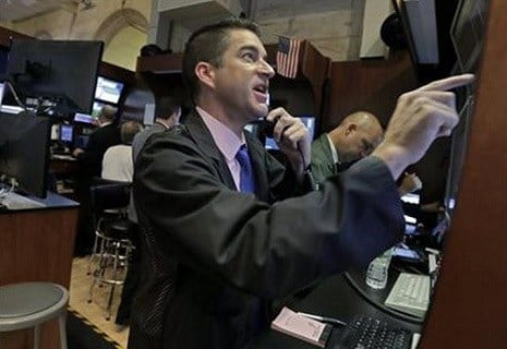 Dennis Ulikowski works in a both on the floor of the New York Stock Exchange, Wednesday, Aug. 26, 2015. U.S. stocks are opening sharply higher Wednesday after slumping for six straight days amid concern that growth in China was slowing more quickly.