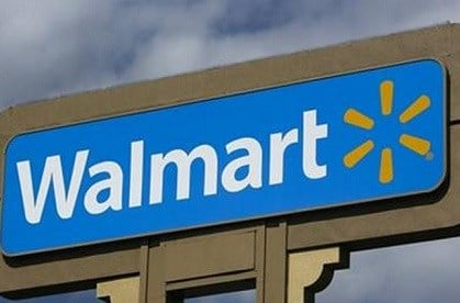 Wal-Mart will stop selling the AR-15 rifle and other semi-automatic weapons at its stores because fewer people are buying them, a spokesman said Wednesday, Aug. 26, 2015. (AP Photo/Damian Dovarganes, File)