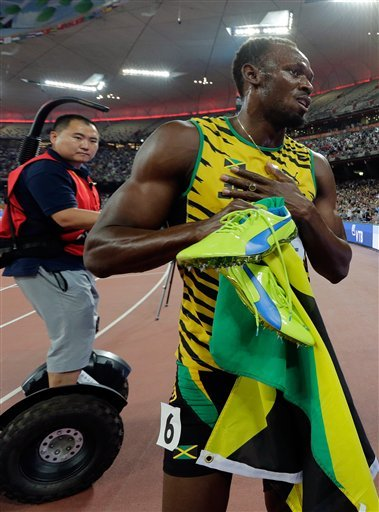 Jamaica's Usain Bolt celebrates after winning the gold in the men's 200m final at the World Athletics Championships at the Bird's Nest stadium in Beijing, Thursday, Aug. 27, 2015.