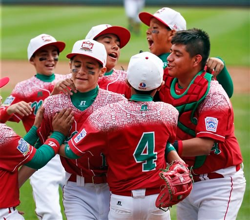 Mexico's Gerardo Lujano, second from left, celebrates with teammates after getting the final out of an International elimination baseball game against Venezuela at the Little League World Series.