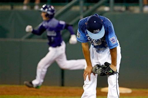Pearland, Texas' Caleb Low, left rear, rounds first behind Bonita, Calif.'s Jacob Baptista after hitting a walkoff two-run home run during the eighth inning.