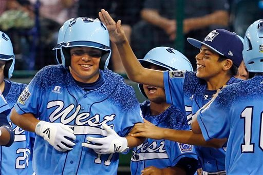 Bonita, Calif.'s Levi Mendez, left, celebrates with teammates after hitting a solo home run off Pearland, Texas' Ben Gottfried in the third inning.