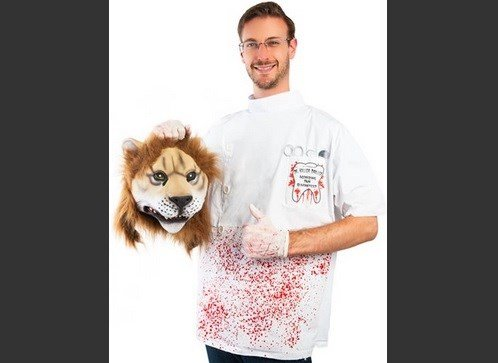 This image released by Costumeish shows a man holding a fake lion head while dressed as a dentist, a costume referring to the Minnesota dentist who who killed Cecil the lion.  AP