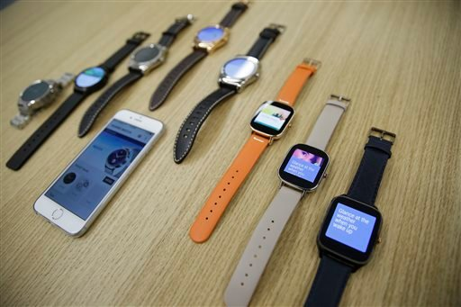 Aug. 21, 2015 file photo: Android Wear smartwatches compatible with the Apple iPhone are displayed at Google's offices in San Francisco. (AP Photo/Eric Risberg)