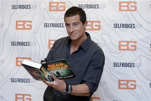 In this June 4, 2015 file photo, British writer and TV presenter Bear Grylls poses for photographers before signing copies of his new book at Selfridges in London.