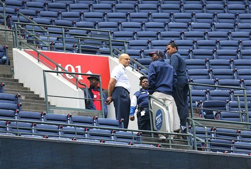 Atlanta Braves employees stand at the portal of section 401 near where fan Gregory K. Murrey, 60, Alpharetta, Ga., fell from the top deck to his death during Saturday's game between the Braves and the New York Yankees, Sunday, Aug. 30, 2015, in Atlanta.