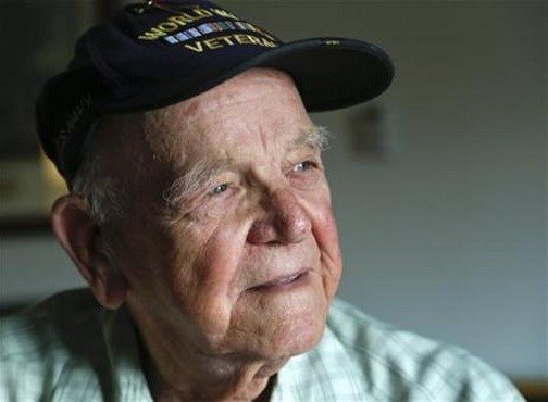 On the day Japan formally surrendered to end WWII, the young sailor from upstate New York was transmitting the news to the world that the bloodiest conflict in history was officially over. (AP Photo/Mike Groll)