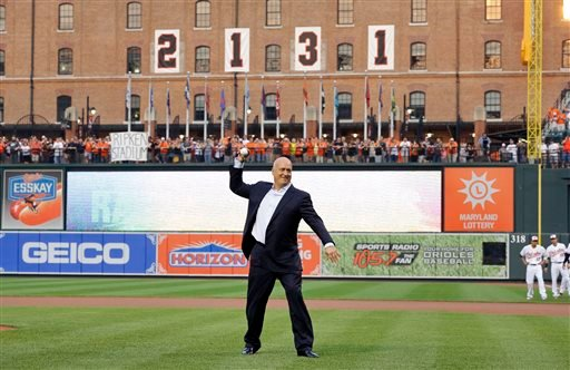 Former Baltimore Oriole Cal Ripken, Jr., throws out the ceremonial first pitch to mark the twentieth anniversary of his streak of 2,131 straight games.
