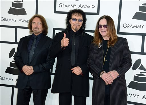 In this Jan. 26, 2014 file photo, Geezer Butler, from left, Tony Iommi and Ozzy Osbourne of Black Sabbath arrive at the 56th annual Grammy Awards in Los Angeles. Black Sabbath will launch a farewell tour next year. The heavy metal band starring Ozzy Osbou