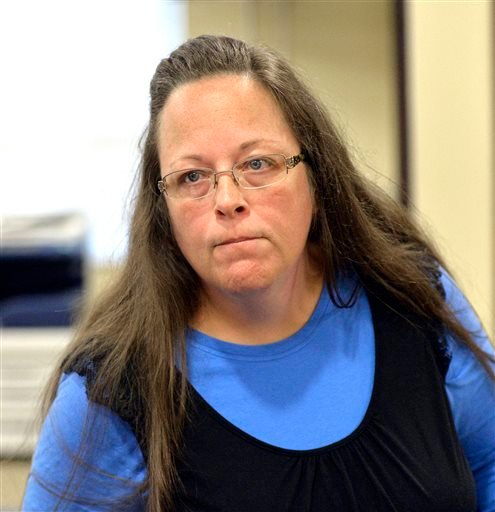 Rowan County Clerk Kim Davis listens to a customer following her office's refusal to issue marriage licenses at the Rowan County Courthouse in Morehead, Ky., Tuesday, Sept. 1, 2015. Although her appeal to the U.S. Supreme Court was denied, Davis still ref