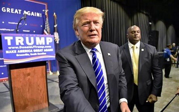 Republican presidential candidate Donald Trump greets supporters after speaking at a rally at the TD Convention Center in Greenville, S.C. NBC announced Tuesday, Sept. 1, that Trump will sit down with host Jimmy Fallon to discuss his campaign. AP