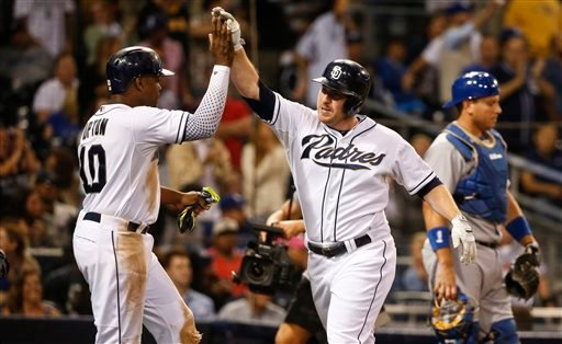 San Diego Padres' Jedd Gyorko, right, is congratulated by Justin Upton after his two-run home tun against the Los Angeles Dodgers during the eighth inning of a baseball game Thursday, Sept. 3, 2015, in San Diego.