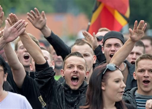 In this Friday, June 26, 2015 file photo protestors demonstrate against the accommodation for immigrants in Freital, Germany, near Dresden. Members of Pegida, the right-wing movement that staged regular rallies in Dresden and elsewhere against immigrants