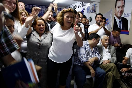Supporters of television comedian and presidential candidate for the National Front of Convergence party Jimmy Morales, cheer upon listening to the preliminary results of the general elections at their party headquarters in Guatemala City, Sunday, Sept. 6