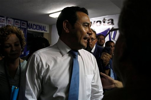 Television comedian and presidential candidate for the National Front of Convergence party Jimmy Morales, smiles prior a press conference at his party headquarters in Guatemala City, Sunday, Sept. 6, 2015. Guatemalans headed to the polls Sunday to elect a