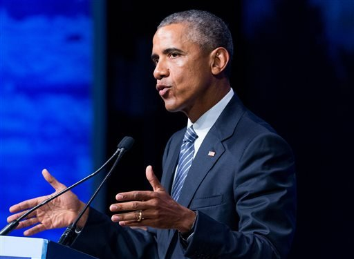 In this Aug. 31, 2015 file photo, President Barack Obama speaks in Anchorage, Alaska. Obama will sign an executive order Monday, Sept. 7, requiring paid sick leave for employees of federal contractors, including 300,000 who currently receive none. (AP Pho