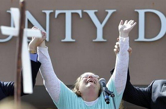County Clerk Kim Davis cries out after being released from the Carter County Detention Center, Tuesday, Sept. 8, 2015, in Grayson, Ky. Davis, the Kentucky county clerk who was jailed for refusing to issue marriage licenses to gay couples, was released.