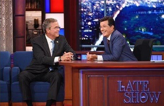 "Stephen Colbert, right, talks with Republican presidential candidate Jeb Bush during the premiere episode of ""The Late Show,"" Tuesday Sept. 8, 2015, in New York. Bush and actor George Clooney were the guests for Colbert's debut. (Jeffrey R. Staab/CBS) AP"