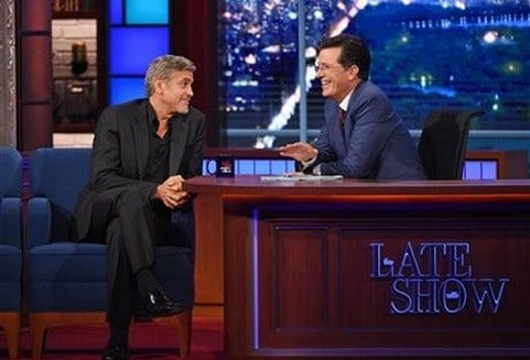 "Stephen Colbert, right, talks with actor George Clooney during the premiere episode of ""The Late Show,"" Tuesday Sept. 8, 2015, in New York. Clooney and Republican presidential candidate Jeb Bush were the guests for Colbert's debut. (Jeffrey R. Staab/CBS)"