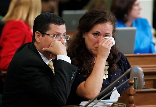 Assemblywoman Lorena Gonzalez, D-San Diego, wipes her eyes as she talks with Assemblyman Rudy Salas, Jr., D-Bakersfield, after her emotion filled speech against a right-to-die measure before the Assembly, Wednesday, Sept. 9, 2015, in Sacramento, Calif. On