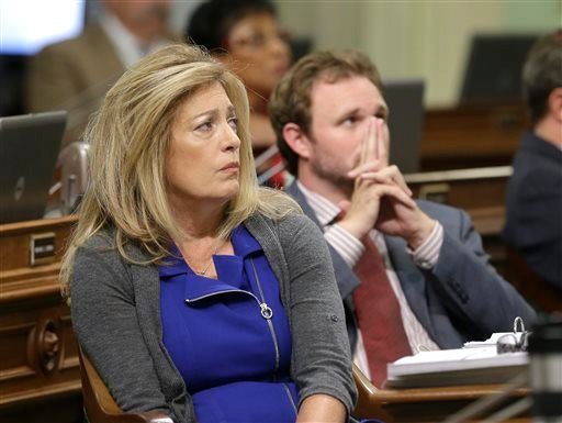 Assemblywoman Marie Waldron, R-Escondido, and James Gallagher, R-Nicolaus, watch as the votes are posted for a right-to-die measure before by the state Assembly Wednesday, Sept. 9, 2015, in Sacramento, Calif. By a 42-33 vote the Assembly approved the bill