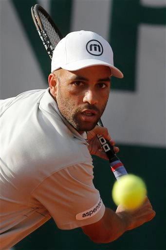 In this May 26, 2013, file photo, James Blake makes a return against Serbia's Viktor Troicki in their first round match of the French Open tennis tournament in Paris.