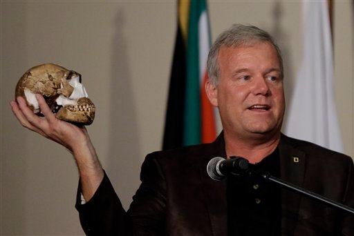 Lee Berger, a professor at the University of the Witwatersrand, holds a reconstruction of the skull of Homo naledi at Magaliesburg, South Africa, Thursday, Sept. 10, 2015. Scientists say they've discovered a new member of the human family tree, revealed b