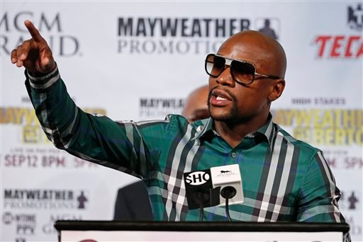 Boxer Floyd Mayweather Jr. speaks during a news conference Wednesday, Sept. 9, 2015, in Las Vegas. Mayweather is scheduled to defend his WBC and WBA Super World welterweight titles against Andre Berto on Saturday. (AP Photo/John Locher)