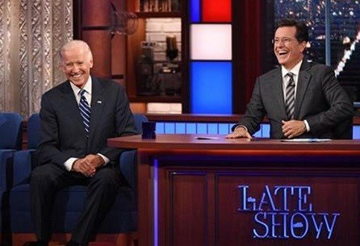 """In this image released by CBS, host Stephen Colbert, right, laughs with Vice President Joe Biden during a taping of """"The Late Show with Stephen Colbert,"""" on Thursday, Sept. 10, 2015 in New York. (John Paul Filo/CBS via AP) MANDATORY CREDIT; NO ARCHIVE; NO"""