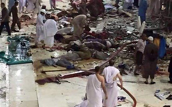 Pilgrims and first responders gather at the site of a crane collapse that killed dozens inside the Grand Mosque in Mecca, Saudi Arabia, Friday, Sept. 11, 2015. The accident happened as pilgrims from around the world converged on the city.