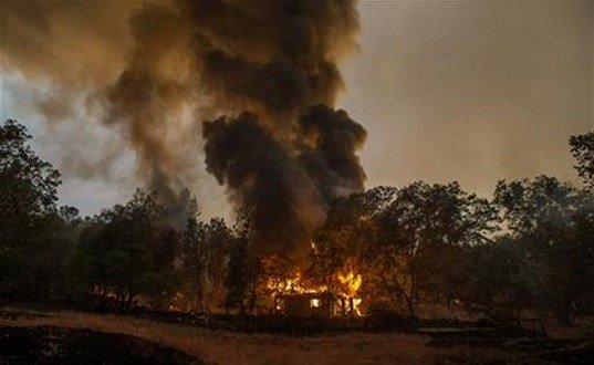 A home burns near Mokelumne Hill, in Jackson, Calif. Another round of evacuations has been ordered as wildfires continue to rage in the central and northern part of the state. (Andrew Sent/The Sacramento Bevia AP)