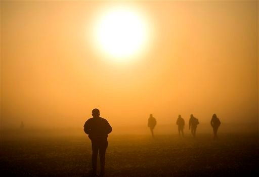 Migrants and refugees walk through a field to avoid checkpoints along the railway tracks connecting Horgos and Szeged near Roszke, at the border between Hungary and Serbia, Sunday, Sept. 13, 2015. (Balazs Mohai/MTI via AP)