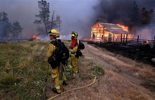A barn burns in Whispering Pines on Cobb Mountain, Calif., Saturday, Sept. 12, 2015. (Kent Porter/The Press Democrat via AP)