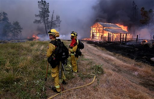 A barn burns in Whispering Pines on Cobb Mountain, Calif., Saturday, Sept. 12, 2015. (Kent Porter/The Press Democrat via AP)