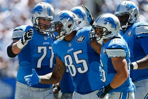 Detroit Lions tight end Eric Ebron (85) celebrates his touchdown with teammates against the San Diego Chargers during the first half of an NFL football game, Sunday, Sept. 13, 2015, in San Diego. (AP Photo/Alex Gallardo)