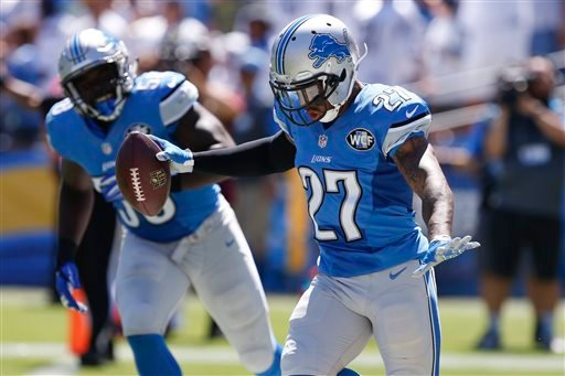 Detroit Lions free safety Glover Quin reacts after scoring a touchdown off an interception against the San Diego Chargers during the first half of an NFL football game Sunday, Sept. 13, 2015, in San Diego. (AP Photo/Alex Gallardo)