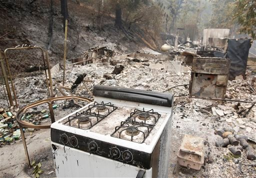 A kitchen stove sits among the remains of home, Sunday, Sept. 13, 2015, destroyed by a fire near Mokelumne Hill, Calif. (AP Photo/Rich Pedroncelli)