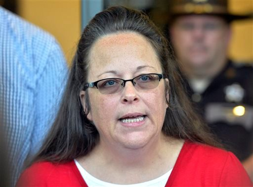 Rowan County Clerk Kim Davis makes a statement to the media at the front door of the Rowan County Judicial Center in Morehead, Ky., Monday, Sept. 14, 2015. (AP Photo/Timothy D. Easley)