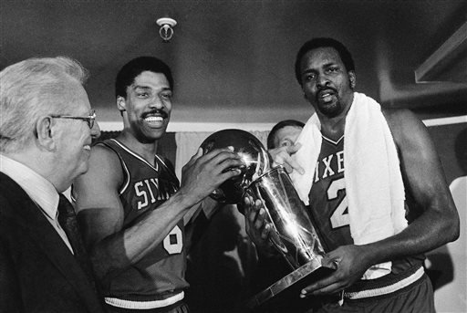 In this Tuesday, May 31, 1983 file photo, Philadelphia 76ers Julius Erving, left, and Moses Malone, right, hold the NBA Championship trophy after defeating the Los Angeles Lakers in Los Angeles.