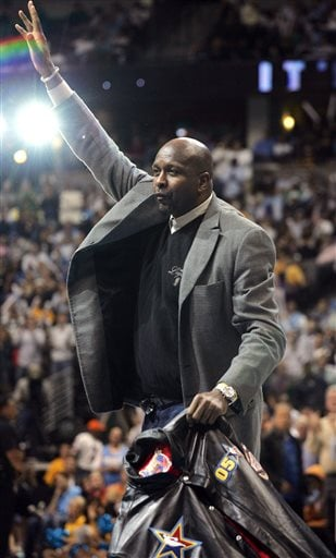 In a April 29, 2006 file photo, NBA Hall-of-Famer Moses Malone acknowledges the crowd during a break in Game 4 of the Los Angeles Clippers against the Denver Nuggets NBA basketball Western Conference first-round playoff series in Denver.
