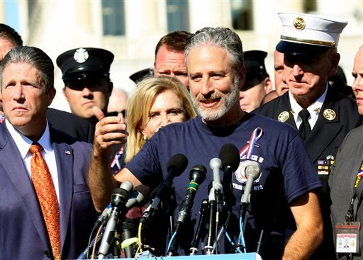 Comedian Jon Stewart stands with New York City first responders during a rally on Capitol Hill in Washington, Wednesday, September 16, 2015, calling for the extension of the the Zadroga Heath & Compensation Act that provides health care and compensation t