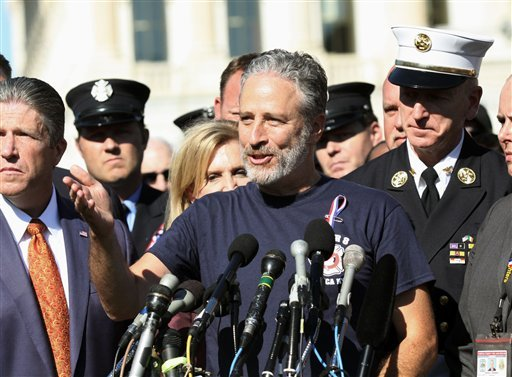 Comedian Jon Stewart stands with New York City first responders and speaks during a rally on Capitol Hill in Washington, Wednesday, September 16, 2015, calling for the extension of the the Zadroga Heath & Compensation Act that provides health care and com