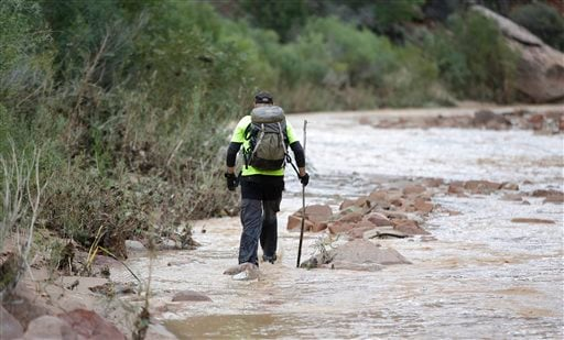 A member of a search and rescue team searches along the Virgin River Wednesday, Sept. 16, 2015, in Zion National Park, near Springdale, Utah. AP Photo/Rick Bowmer)