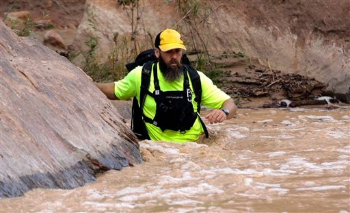 A member of a search and rescue team wades in to Virgin River during a search Wednesday, Sept. 16, 2015, in Zion National Park, near Springdale, Utah. (AP Photo/Rick Bowmer)