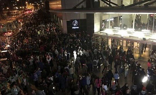 People evacuate a mall in Santiago after a powerful earthquake, in Santiago, Chile, Wednesday, Sept. 16, 2015. The magnitude-8.3 earthquake hit off Chile's northern coast causing buildings to sway in Santiago. AP