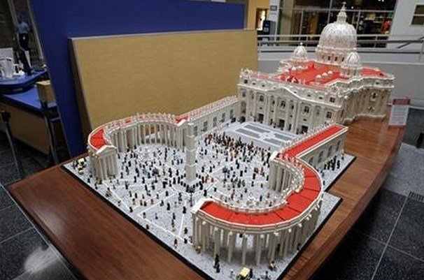 In this Friday, Sept. 11, 2015 photo, The Rev. Bob Simon poses for a photograph with his Lego representation of the St. Peter's basilica and square, at The Franklin Institute in Philadelphia. (AP Photo/Matt Rourke)