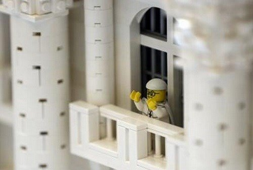 In this Friday, Sept. 11, 2015 photo, shown a Lego pope figure on a balcony overlooking the crowd in the piazza in a Lego representation of the St. Peter's basilica and square.