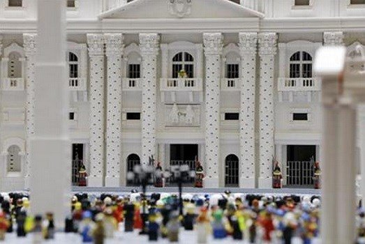 In this Friday, Sept. 11, 2015 photo, shown a Lego pope figure on a balcony overlooking the crowd in the piazza in a Lego representation of the St. Peter's basilica and square. AP