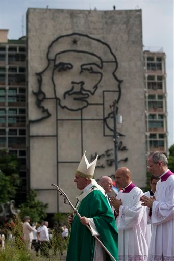 """Pope Francis holds his pastoral staff as he arrives to celebrate Mass at Revolution Plaza in Havana, Cuba, Sunday, Sept. 20, 2015, where a sculpture of revolutionary hero Ernesto """"Che"""" Guevara decorates a nearby government building. Pope Francis opens his"""