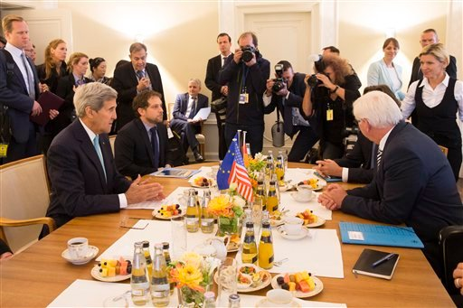 U.S. Secretary of State John Kerry, left, meets with German Foreign Minister Frank-Walter Steinmeier at Villa Borsig about the ongoing crisis in Syria, Berlin, Sunday, Sept. 20, 2015. (AP Photo/Evan Vucci, Pool)